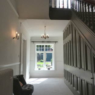 Inspiration for a contemporary carpeted hallway remodel in Other with white walls