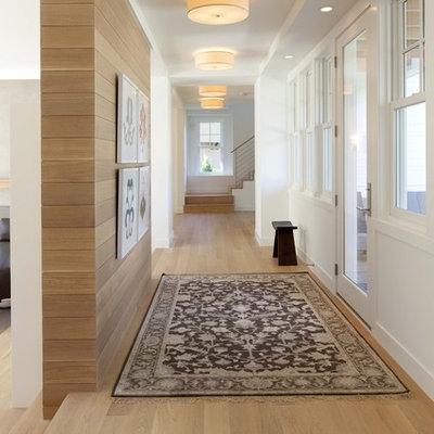 Trendy medium tone wood floor and beige floor hallway photo in Minneapolis with white walls