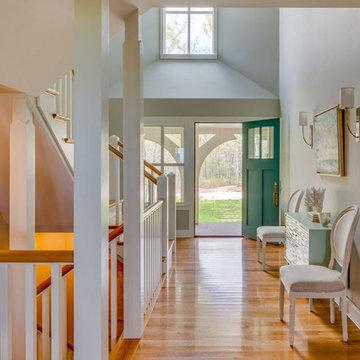 Entryway Hall & Teal Blue Front Door - Boston Magazine Design Home
