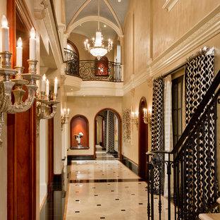 Large elegant marble floor and multicolored floor hallway photo in Phoenix with beige walls