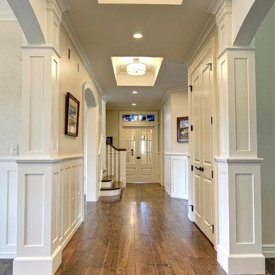 Hallway - traditional medium tone wood floor and brown floor hallway idea in Other with beige walls