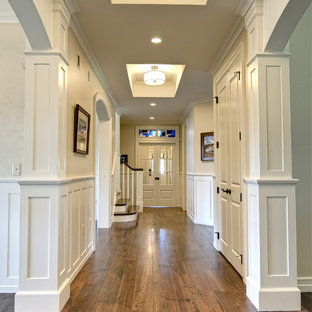 Hallway - traditional medium tone wood floor and brown floor hallway idea in Other with beige walls