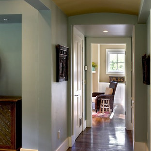 Hallway - farmhouse dark wood floor hallway idea in Burlington with blue walls