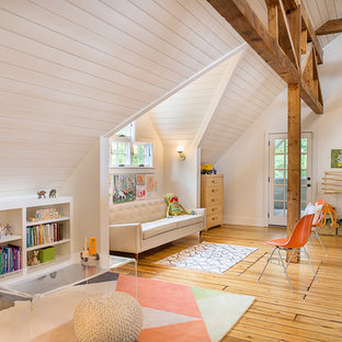 Example of a large minimalist light wood floor and beige floor hallway design in Boston with white walls