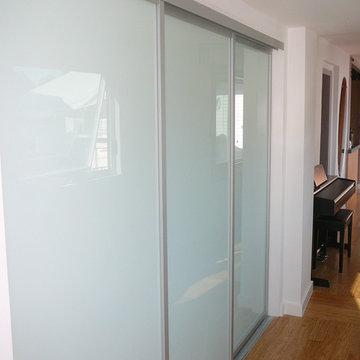 First Floor Hall - Laundry Closet behind Sliding Glass Doors