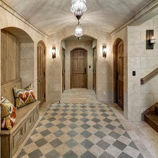 Hallway - traditional limestone floor hallway idea in New York with beige walls