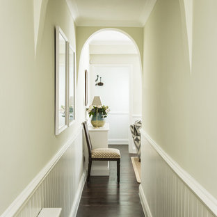 Example of a small classic dark wood floor hallway design in London with green walls