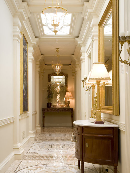 Example of a classic beige floor hallway design in San Francisco with white  walls