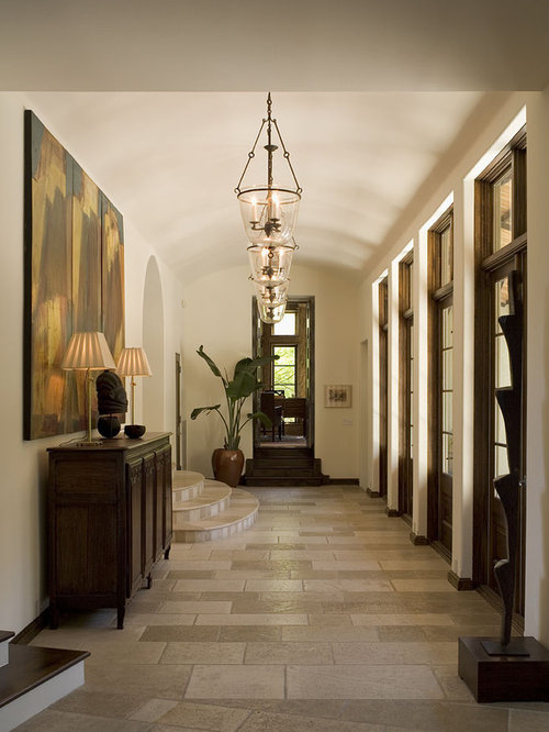Ex&le of a classic travertine floor hallway design in Austin with white walls & Foyer Credenza   Houzz azcodes.com