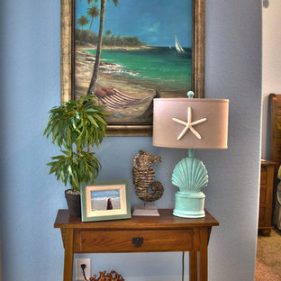 Inspiration for a small beach style hallway in Houston with blue walls and carpet.