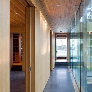 Mid-sized minimalist hallway photo in Vancouver