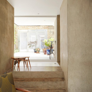 Photo of a small midcentury hallway in Cambridgeshire with grey walls, concrete floors and white floor.