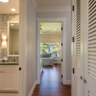 Photo of a beach style hallway in Hawaii with grey walls, vinyl floors and brown floor.