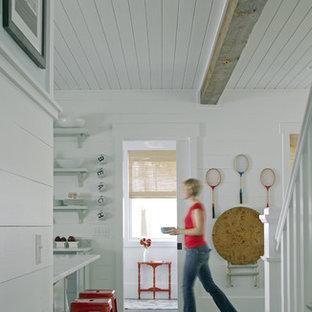 Photo of a beach style hallway in Atlanta with white walls and slate floors.