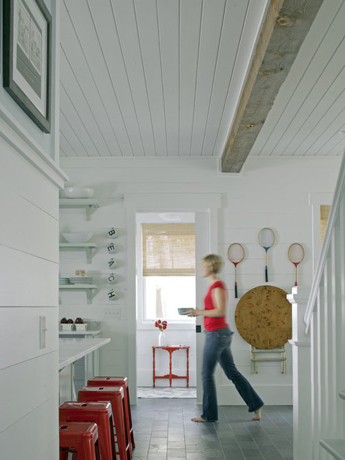 Inspiration for a beach style hallway remodel in other with white