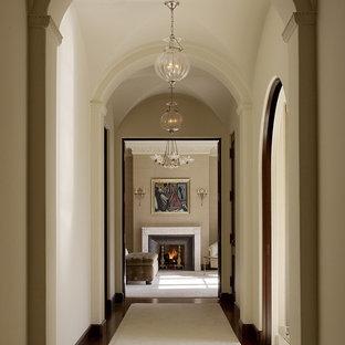 Hallway - mediterranean medium tone wood floor hallway idea in San Francisco with beige walls