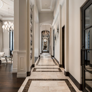 Hallway - huge mediterranean porcelain tile and multicolored floor hallway idea in Phoenix with white walls
