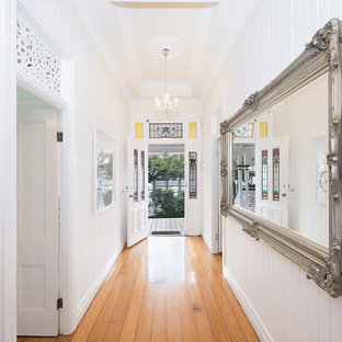 75 most popular hallway with medium hardwood floors design ideas forthis is an example of a traditional hallway in brisbane with white walls and medium hardwood