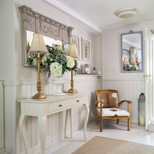 Example of a mid-sized cottage chic ceramic floor and white floor hallway design in Gloucestershire with gray walls