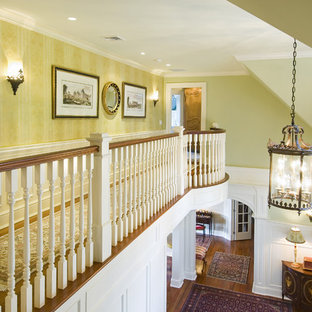 Inspiration for a timeless medium tone wood floor hallway remodel in Bridgeport with green walls