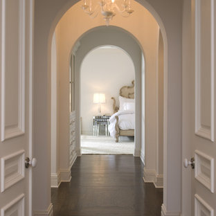 Hallway - mediterranean brown floor hallway idea in Minneapolis with white walls