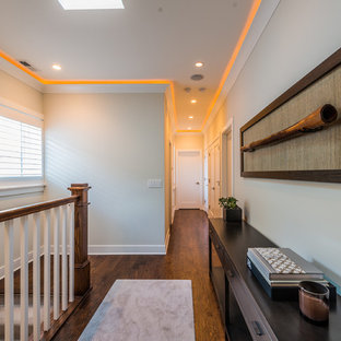Transitional medium tone wood floor hallway photo in Chicago with gray walls