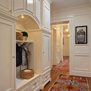 Mid-sized transitional hallway in San Francisco with white walls and medium hardwood floors.