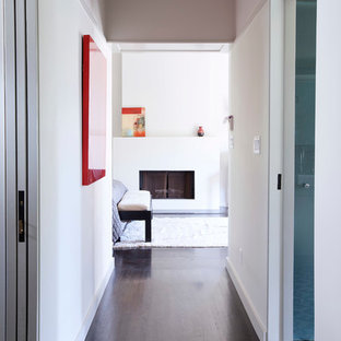 Inspiration for a small contemporary dark wood floor hallway remodel in Los Angeles with beige walls