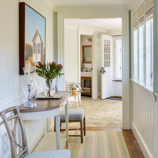 This is an example of a mid-sized beach style hallway in Boston with medium hardwood floors and green walls.