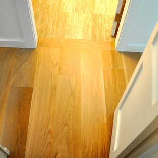 Example of a mid-sized trendy light wood floor and beige floor hallway design in Vancouver with white walls