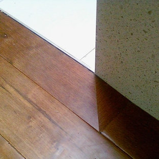 Inspiration for a mid-sized modern dark wood floor and beige floor hallway remodel in Vancouver with white walls
