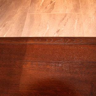 Hallway - huge modern dark wood floor and brown floor hallway idea in Vancouver with beige walls