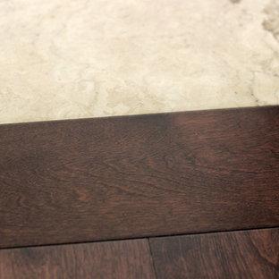 Inspiration for a huge modern dark wood floor and brown floor hallway remodel in Vancouver with beige walls