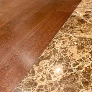 Example of a huge minimalist dark wood floor and brown floor hallway design in Vancouver with beige walls