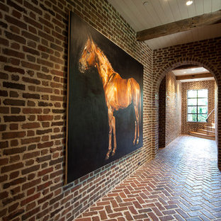 Inspiration for a farmhouse brick floor hallway remodel in Houston