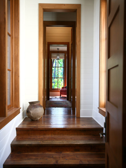Mountain Style Dark Wood Floor Hallway Photo In Seattle With White Walls