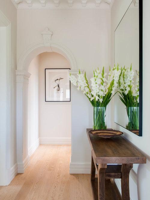 Contemporary Light Wood Floor Hallway Idea In Sydney With Beige Walls