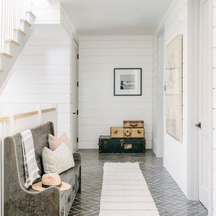 Photo of a beach style hallway in Los Angeles with white walls and grey floor.