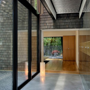 Example of a trendy concrete floor and gray floor hallway design in Seattle