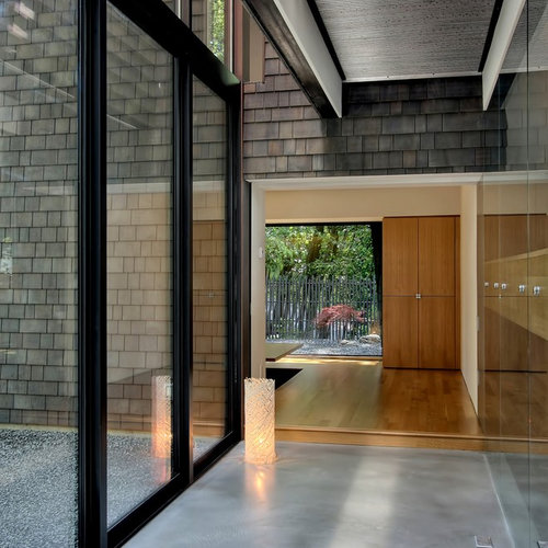 Example Of A Trendy Concrete Floor And Gray Hallway Design In Seattle