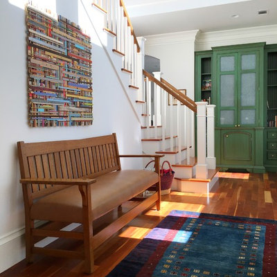 Inspiration for a transitional medium tone wood floor and brown floor hallway remodel in Atlanta with white walls