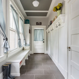 This is an example of an arts and crafts hallway in Raleigh with porcelain floors.