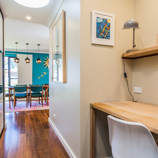 This is an example of an eclectic hallway in Perth with beige walls and medium hardwood floors.