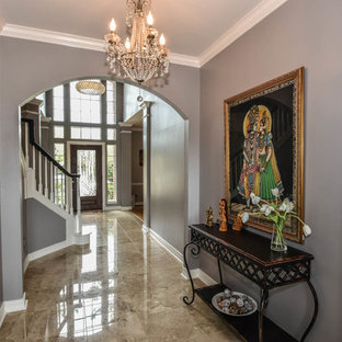 Example of a transitional travertine floor hallway design in Houston with gray walls