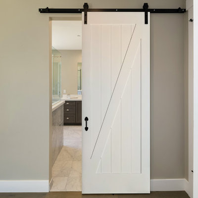 Inspiration for a mid-sized cottage hallway remodel in Vancouver with beige walls