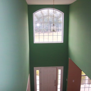 Example of a large transitional hallway design in Philadelphia with green walls