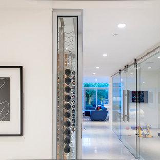 Foto di un ingresso o corridoio design con pareti bianche e pavimento bianco