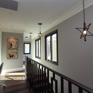 Trendy dark wood floor and brown floor hallway photo in San Diego with gray walls