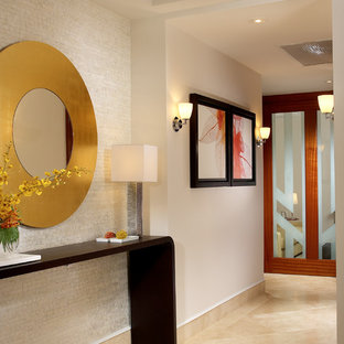 Example of a mid-sized trendy beige floor and marble floor hallway design in Miami with beige walls