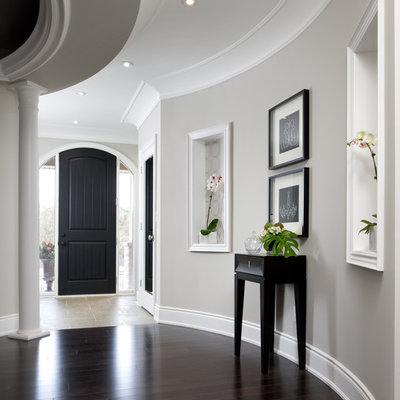 Transitional brown floor hallway photo in Toronto with gray walls